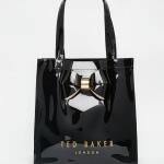 Shopping bag nera lucida di Ted Baker.